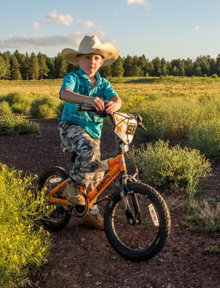 CowboyKidOnBike_KachinaWetlands_HeatherQuinnSon_1714eSmw1200A